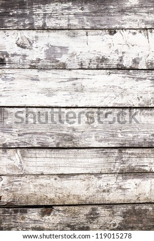 Weathered white painted wooden planks