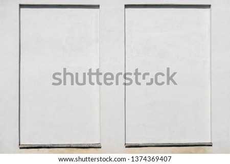 weathered white stucco wall with a stucco frame #1374369407
