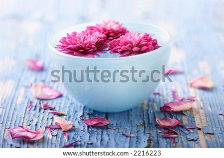weathered wood with bowl of water and flowers