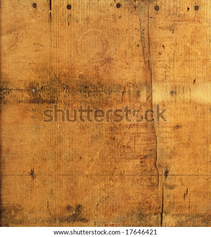 Weathered wood with rusty nails and cracks for background texture.