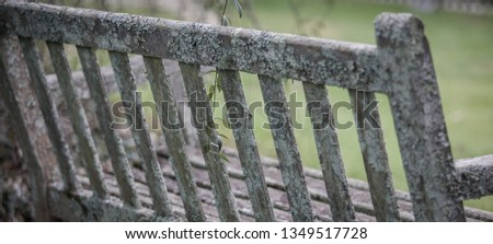 Weathered wooden bench #1349517728