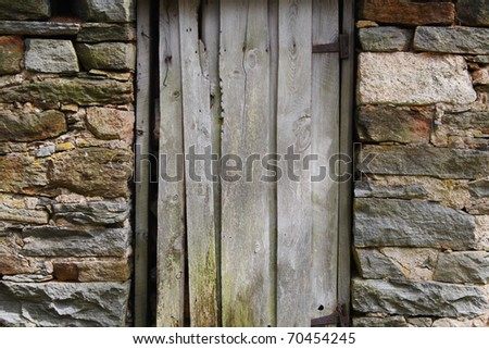 Weathered wooden door in old building