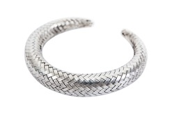 Weave silver bracelet isolated on white background. Round woven silver bangle isolated