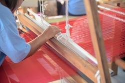 Weaving silk by hand loom