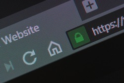 Web browser closeup on LCD with secure https url and visible pixels. Internet security, SSL certificate, cybersecurity, search engine and web browser concepts