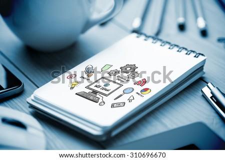 web design against notepad on desk