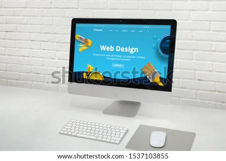 Web design studio concept with modern computer display with web design web site theme concept. #1537103855