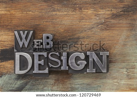 web design - text in vintage letterpress metal type blocks on a grunge painted wood - stock photo
