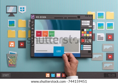 Web designer drafting web templates and web page layouts using a professional software, collage and paper cut composition #744159451