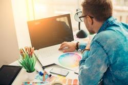 Web designer working on the best framework of a new application