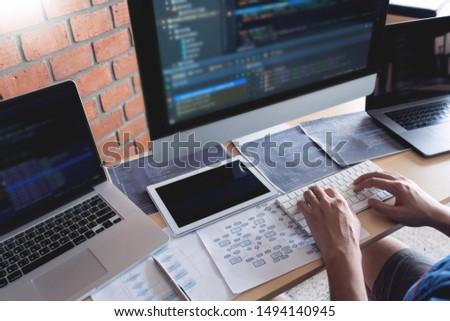 web developer coding for program working on software startup project, focus on programming code development web, developer.