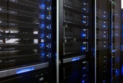 Web network, internet telecommunication technology, big data storage, cloud computing computer service business concept: server room interior in datacenter in blue light