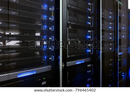 Web network, internet telecommunication technology, big data storage, cloud computing computer service business concept: server room interior in datacenter in blue light #796465402