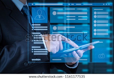 Web page browser of Social media Page VR Interface on the laptop computer.businessman hand using tablet computer and server room background