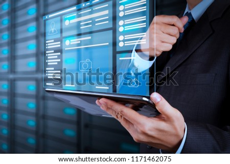 Web page browser of Social media Page VR Interface on the laptop computer.businessman hand using tablet computer and server room background #1171462075