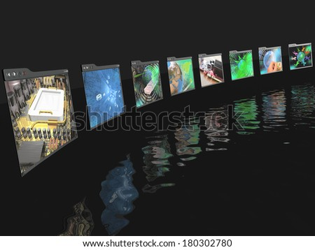Web pages with pictures (computer) on black reflective background.