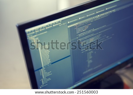Web site codes on computer monitor. #251560003