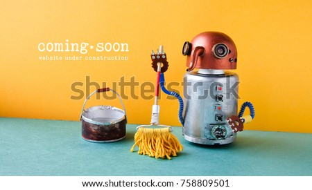 Web site under construction Coming Soon template page. Robot washer with mop and bucket of water, orange wall green floor interior. #758809501