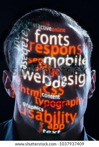 webdesign word cloud on mans face