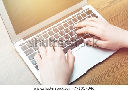 Webdesigner sworking on laptop