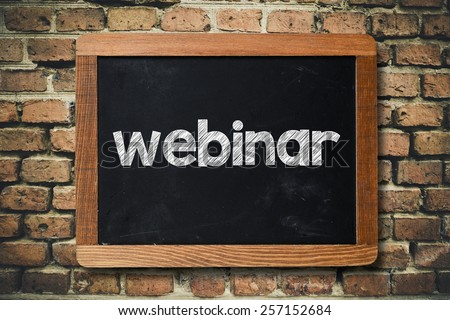 Webinar on Blackboard. Webinar on Blackboard on bricks wall