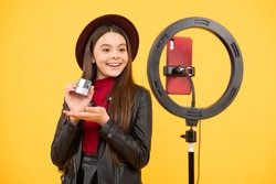 weblog and vlog. makeup tutorial. influencer. happy teen girl use selfie led. kid beauty blogger. childhood happiness. cheerful child do makeup. vlogger with cosmetics. make video blog on smartphone.