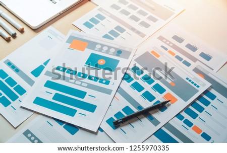 Website designer Creative planning application developer development draft sketch drawing template layout prototype framework wireframe design studio . User experience concept . #1255970335