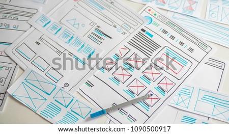 Website designer Creative planning application development  draft sketch drawing template layout framework wireframe design studio . User experience concept .