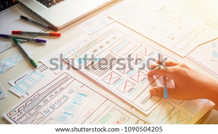 Website designer Creative planning application development  draft sketch drawing template layout framework wireframe design studio . User experience concept .