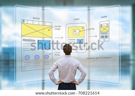 Website development UI/UX front end designer reviewing sketched wireframe layout design mockup for responsive web content with AR screen #708221614
