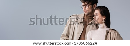website header of fashionable couple looking away isolated on grey