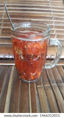 Wedang Uwuh, a traditional drink from Yogyakarta, Indonesia.  Contains various ingredients: cinnamon, nutmeg, and clove leaves, bark from secang trees, granulated sugar