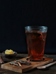Wedang Uwuh, traditional herb drink from Jogjakarta, Indonesia. Contains a variety of leaves: cinnamon, nutmeg and cloves leaves. Another ingredient is wood from the secang tree, ginger and lump sugar
