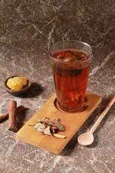 Wedang Uwuh, traditional herb drink from Jogjakarta, Indonesia. Contains a variety of leaves:cinnamon, nutmeg and cloves leaves. Another ingredient is wood from the secang tree, ginger and lump sugar.