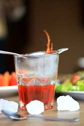 Wedang Uwuh, traditional herb drink from Yogyakarta, Indonesia. Contains a variety of leaves: cinnamon, nutmeg and cloves leaves. Another ingredient is wood from the secang tree, ginger and lump sugar