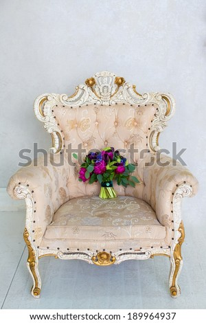 Shutterstock Wedding accessories. Beautiful wedding bouquet of tulips and pions standing vintage-chair