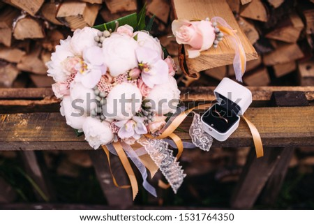 Wedding accessories bride and groom. Bridal bouquet, rings, jewelry, boutonniere and perfume.