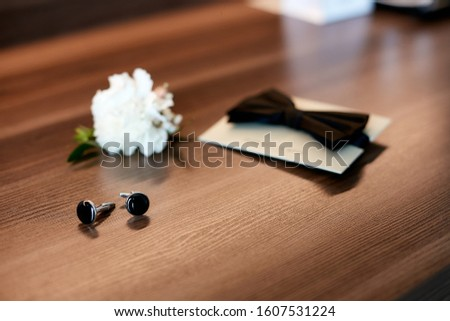 Wedding accessories, cufflinks, bow tie and buttonhole