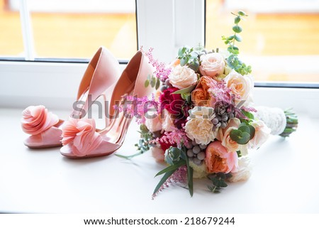 Shutterstock Wedding accessories for the morning of the bride in pink . Wedding bouquet and shoes of the bride.