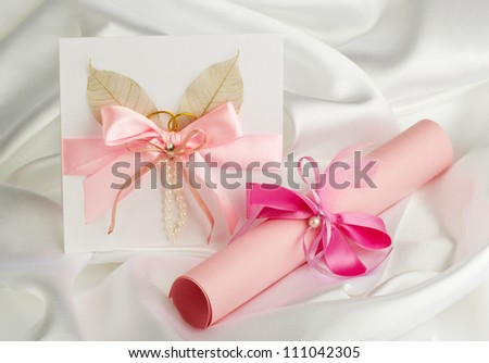 wedding accessories on white satin