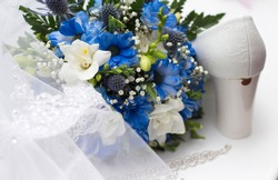 Wedding accessories. White shoe. Bouquet of blue and white flowers. Veil. Necklace. White and blue. Marriage.