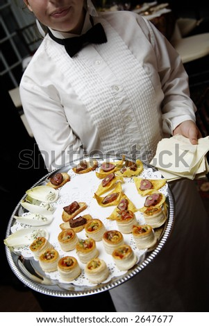 Wedding appetizers being served on a platter