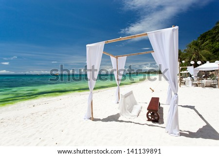 Wedding arch decorated on tropical beach