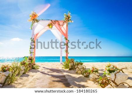 Free photos wedding arch cabana gazebo on tropical beach decorated wedding arch decorated with flowers on tropical sand beach outdoor beach wedding setup 184180265 junglespirit Gallery