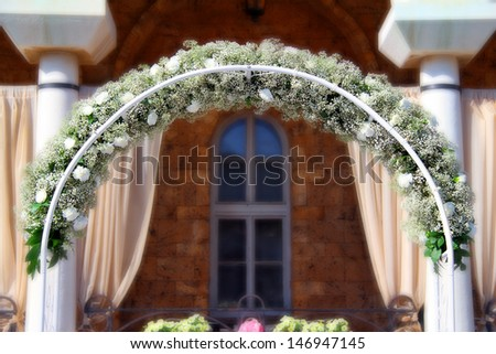 Wedding arch decorated with white flowers