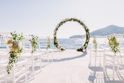 WEDDING ARCH RECEPTION WITH SEA VIEW in Montenegro. White wedding reception venue with sea and mountains view. Destination wedding venue.