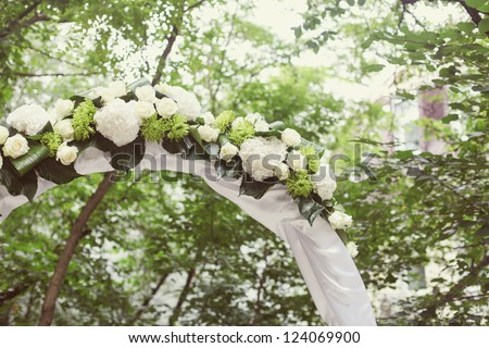 Wedding Arch with flowers on the grass