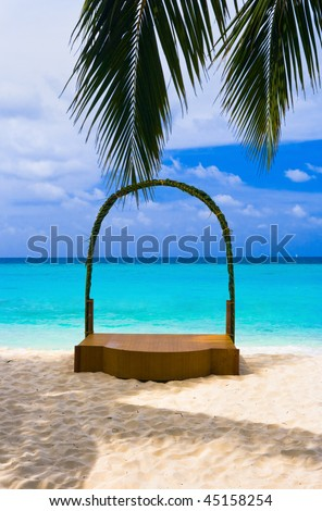 Wedding archway at tropical beach - holiday background