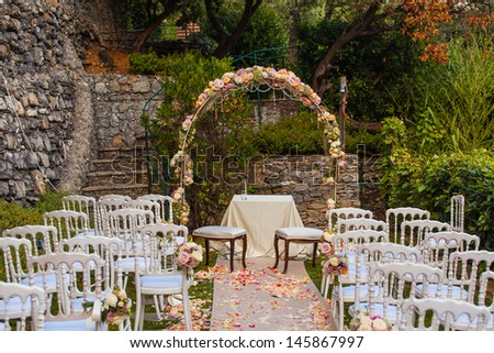 Wedding archway with flowers arranged for wedding ceremony