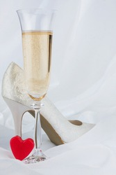 Wedding background, heart, champagne and shoe. Copy space